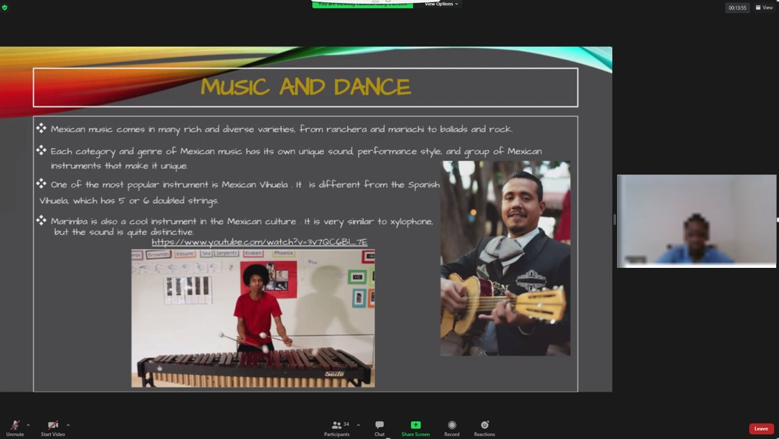 PowerPoint slide with photo of man playing guitar and man playing xylophone